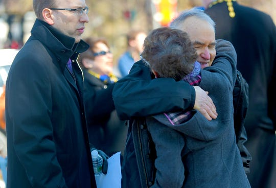 The families of victims Roberta King and Maria Zobniw greet each other before the morning gathering to honor the 13 victims of the 2009 mass shooting at the American Civic Association in Binghamton.