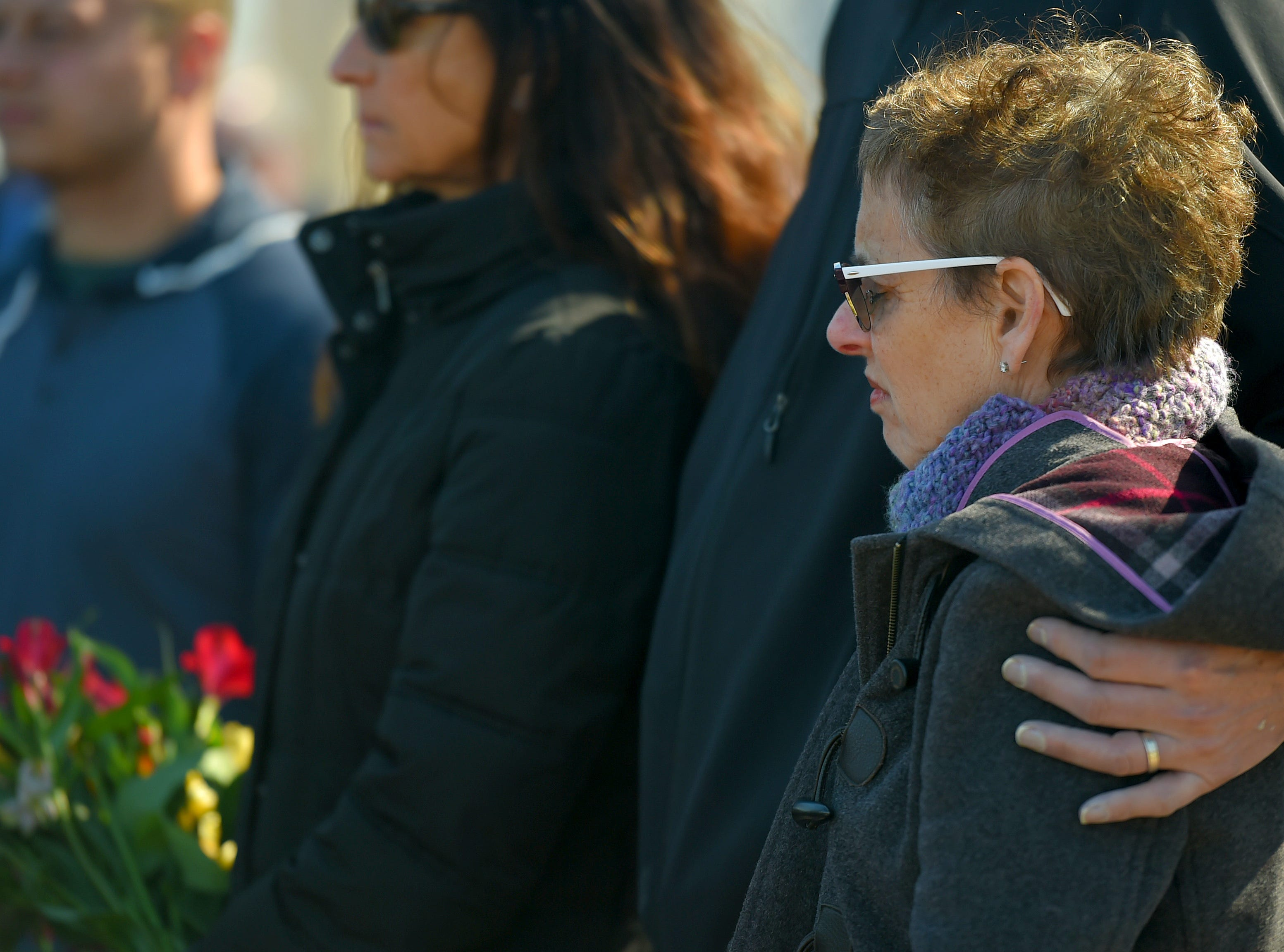 "The family of Roberta ""Bobbie"" King during the memorial service marking the tenth anniversary of the American Civic Association tragedy. King, a teacher at the ACA, was killed during the mass shooting.  April 3, 2019."