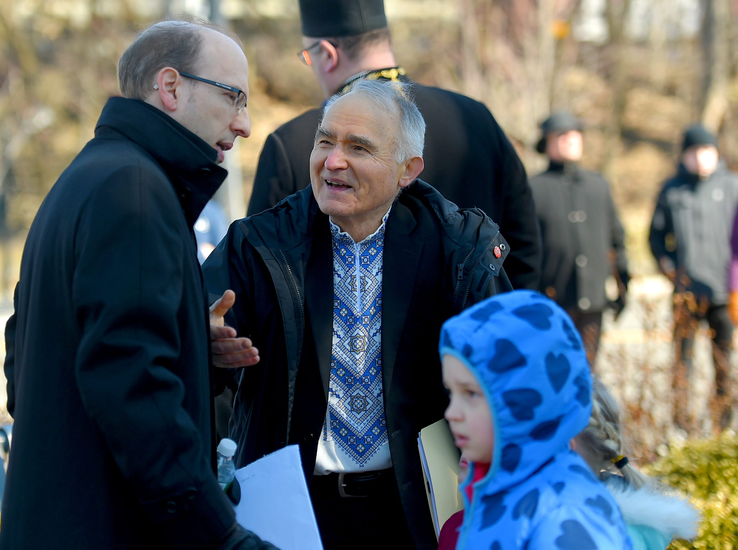Dr. Jeffrey King speaks with Lubomyr Zobniw before the morning gathering to honor 13 victims of the 2009 mass shooting at the American Civic Association in Binghamton. King's mother, Roberta King, and Zobniw's wife, Maria Zobniw, were among those killed in the tragedy.  April 3, 2019.