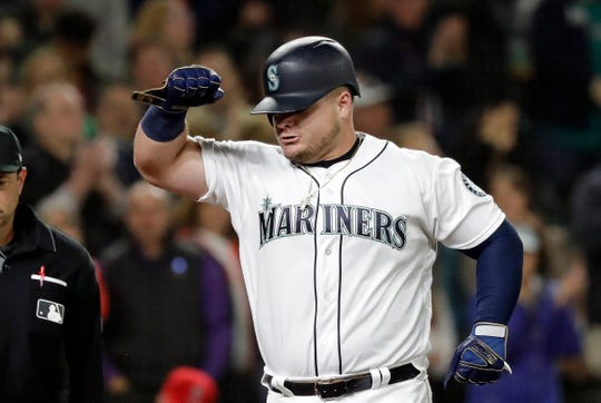 Seattle Mariners' Daniel Vogelbach pumps his fist as he crosses home on his solo home run against the Los Angeles Angels in the eighth inning of a baseball game, Tuesday, April 2, 2019, in Seattle.