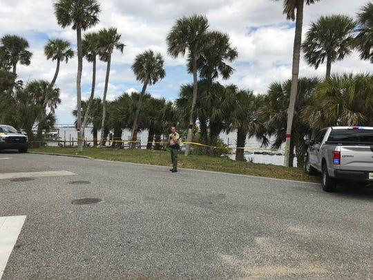 Fish and Wildlife investigators at the scene near Rockledge Drive and Rockledge Avenue where a man's body was found in the lagoon.