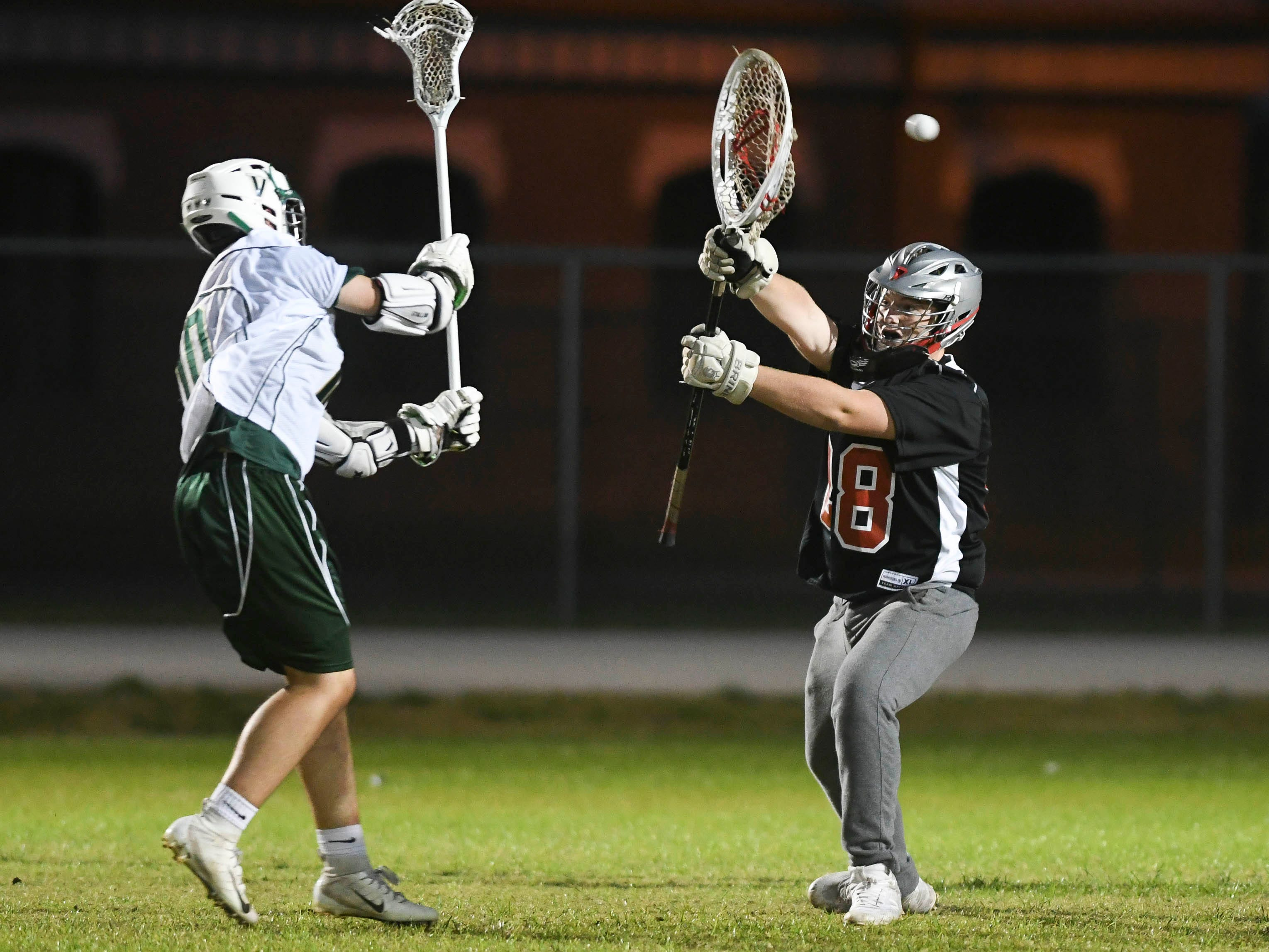 Matt Lynch of Viera shoots and scores over Satellite goalkeeper Jackson Lacy during Tuesday's game in Viera