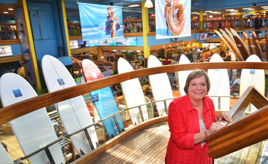Ron Jon Surf Shop President Debbie Harvey stands on the second-story balcony of the 52,000-square-foot Cocoa Beach flagship store.