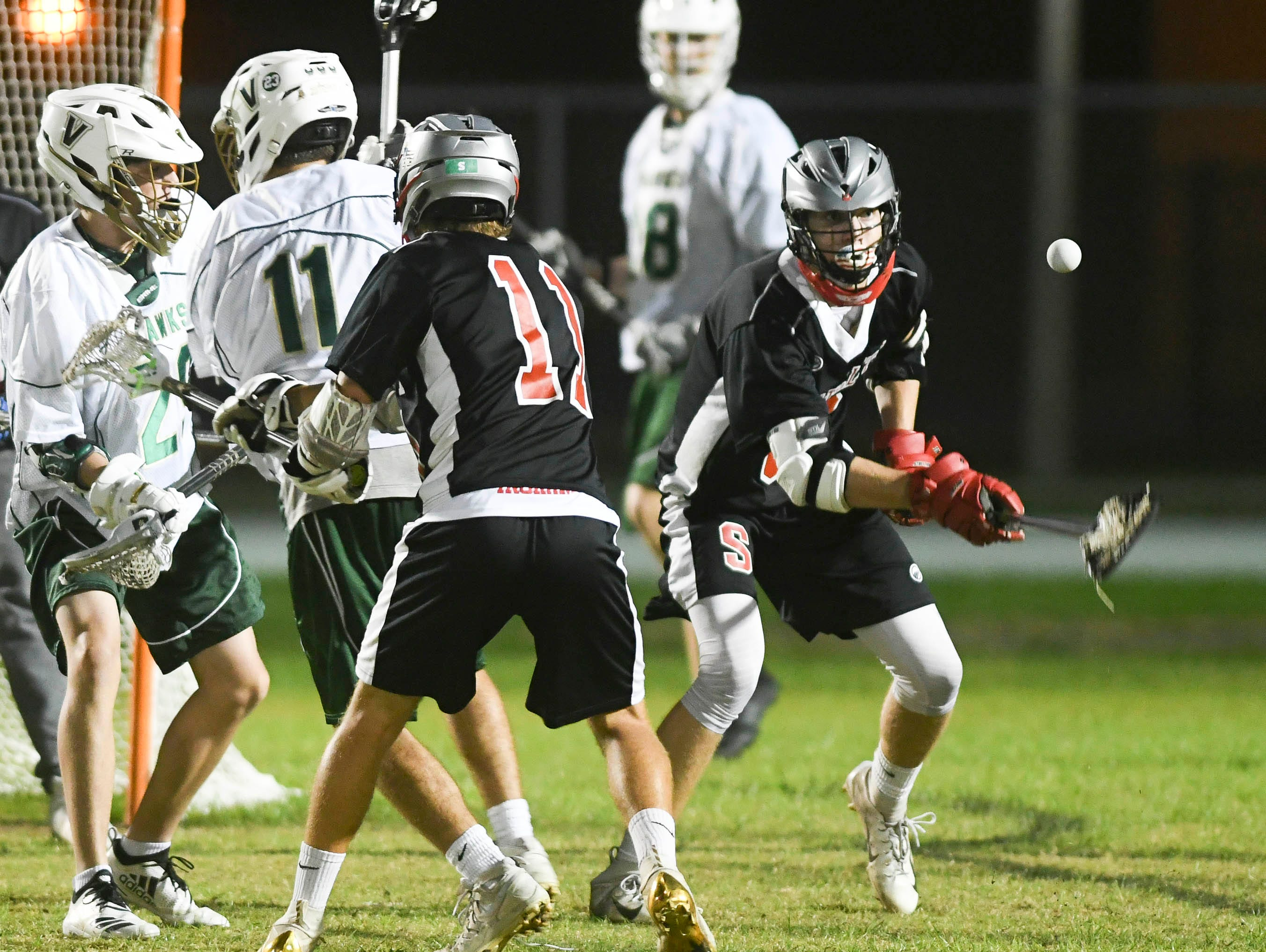 Satellite and Viera players chase a loose ball during Tuesday's game in Viera