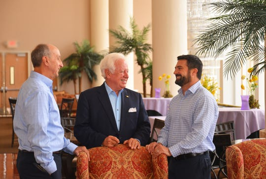 Steve Janicki (left to right), executive director of the King Center, talks with Anthony Catanese, chairman of the King Center board of directors, and Rick Balda, president of Balda Development and Construction, in the Crown Club at the King Center.