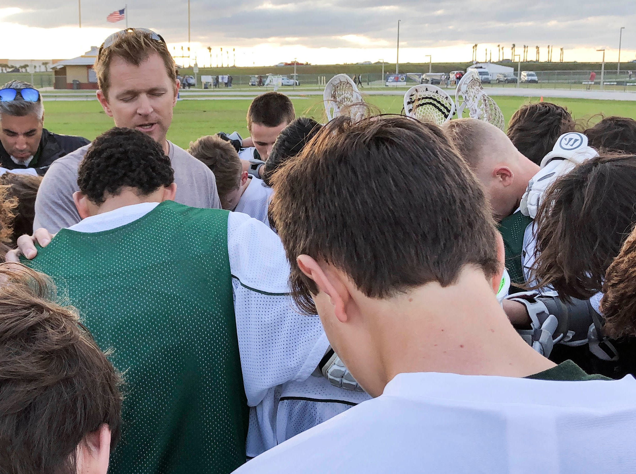 Viera lacrosse players say a prayer prior to Tuesday's game against Satellite.