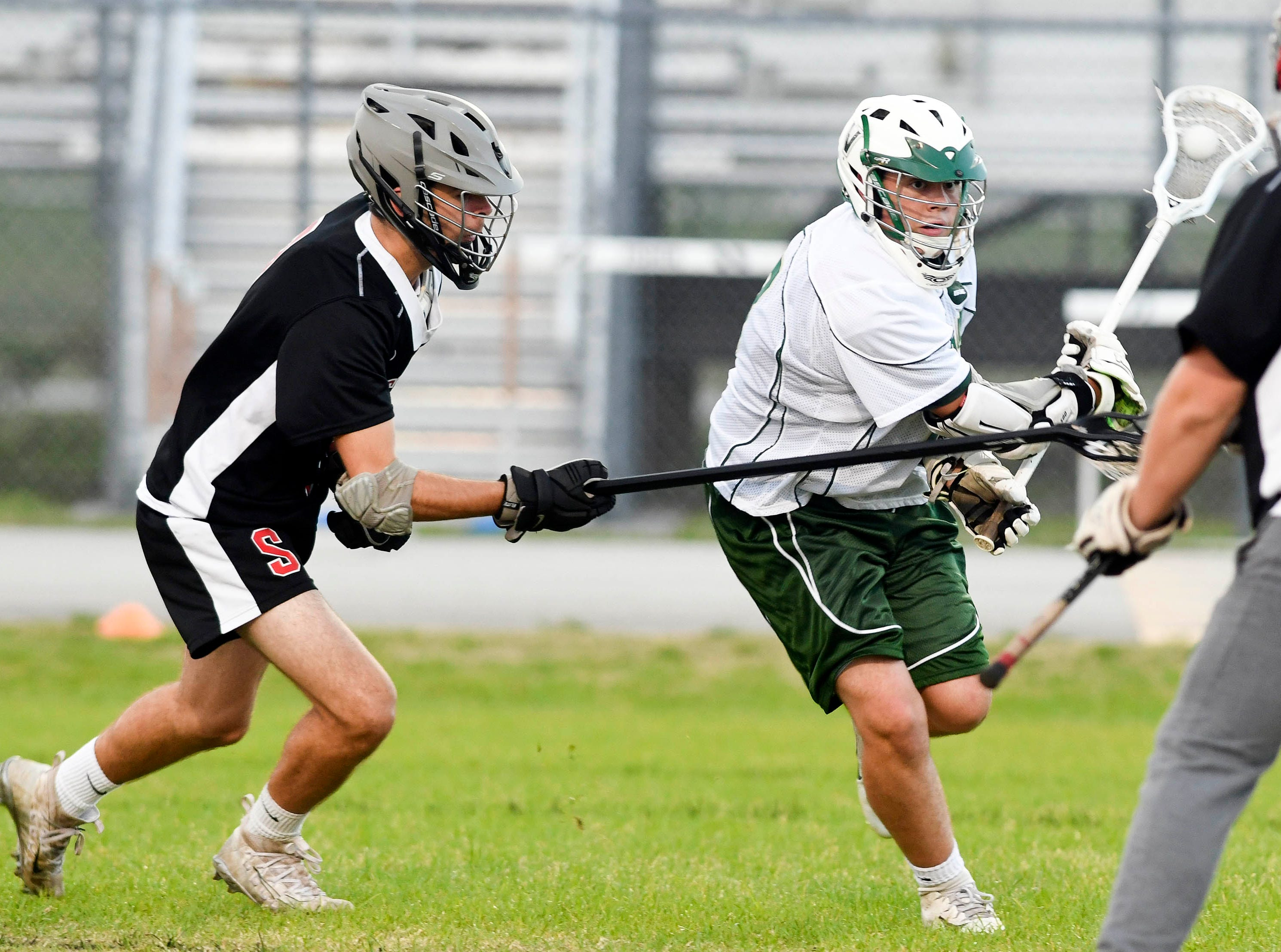 Satellite's Aiden McElroy pursues Matt Lynch of Viera during Tuesday's game.