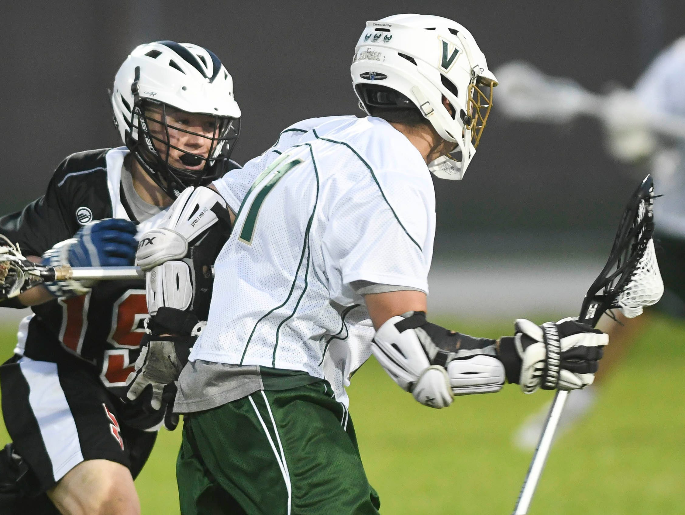 Alex Goodale of Satellite challenges Nick Rodriguez of Viera during Tuesday's game.