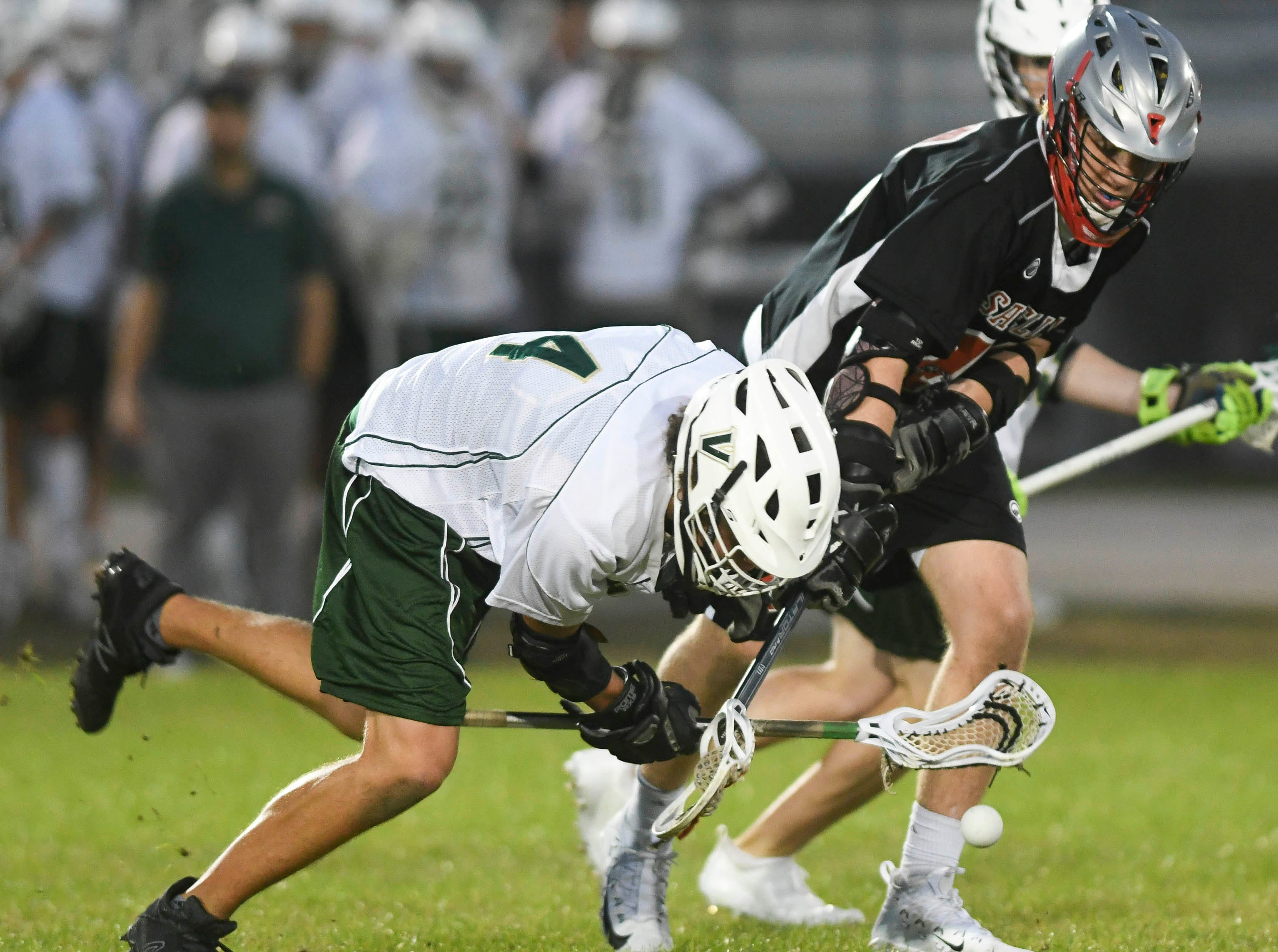 Gavin Wessell of Viera is challenged by Sebastian Rowe of Satellite during Tuesday's game.