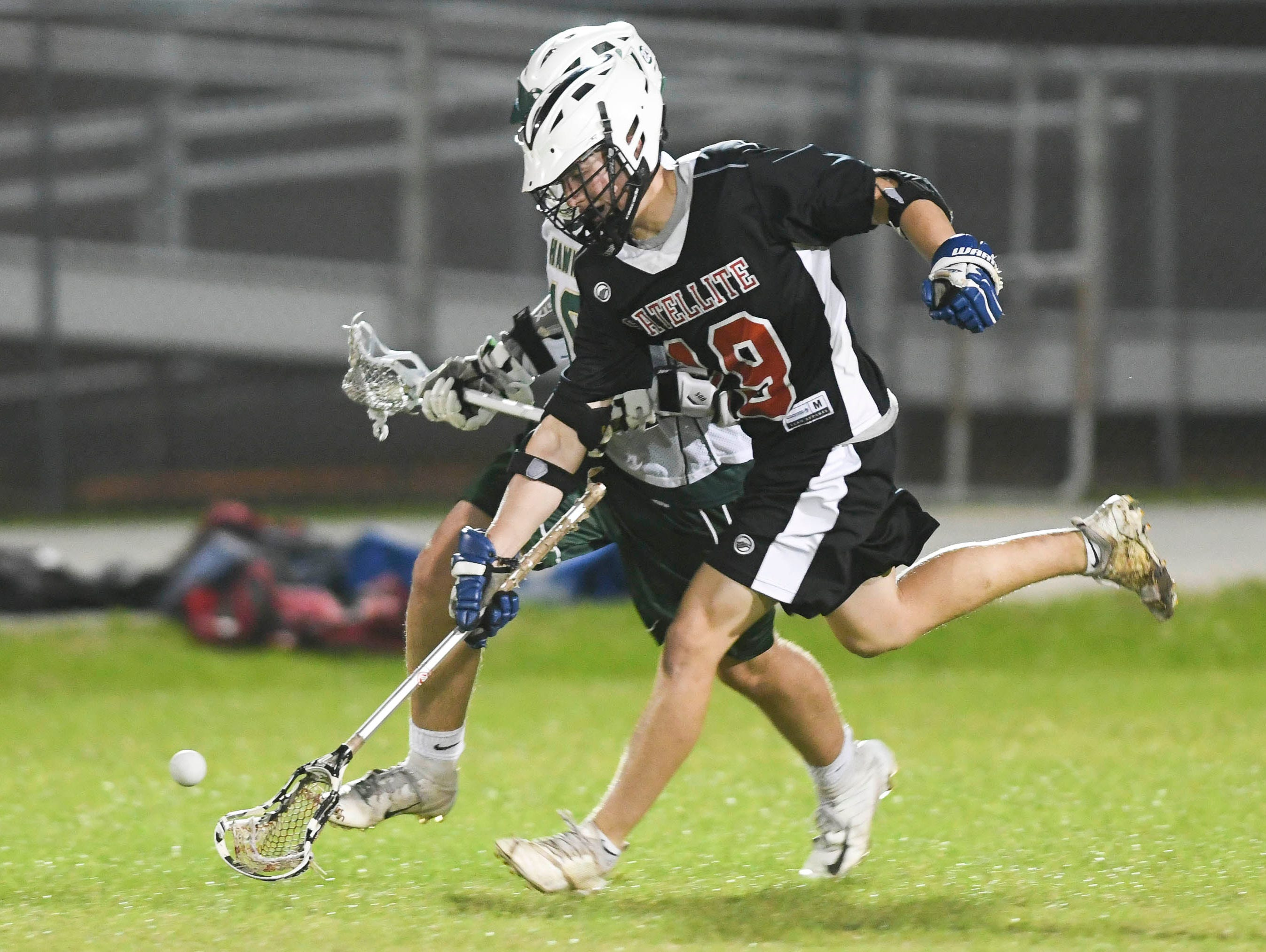 Satellite's Alex Goodale (19) and Matt Lynch of Viera (10) chase the ball during Tuesday's game.