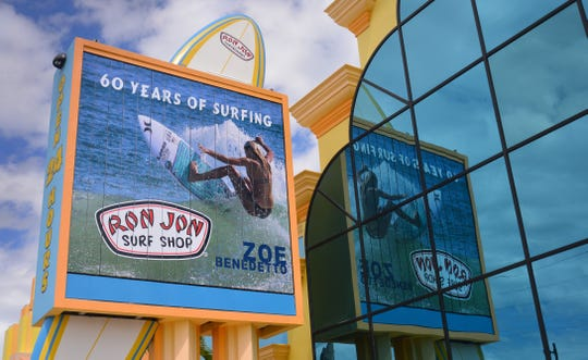 The rotating billboard in front of the store notes 60 years of surfing. Ron Jon Surf Shop will celebrate its 60th anniversary this year, with events planned for the summer.