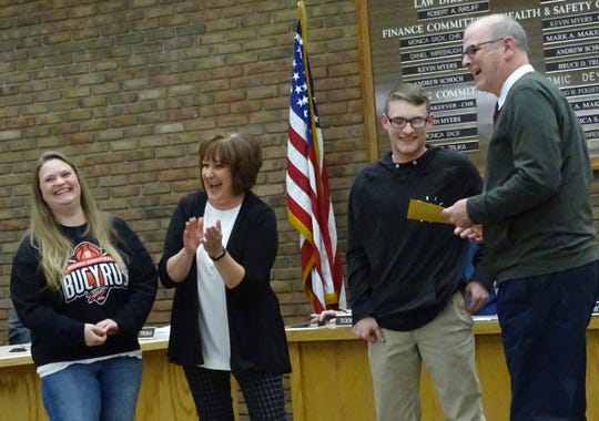 Bucyrus High School junior Tod Spurlock is recognized by Mayor Jeff Reser during Tuesday's Bucyrus City Council meeting for being the first bowler in the county to qualify for the state tournament. From left are Spurlock's  mother, Carrie Young; his coach, Diane Kaple; Spurlock; and Reser.