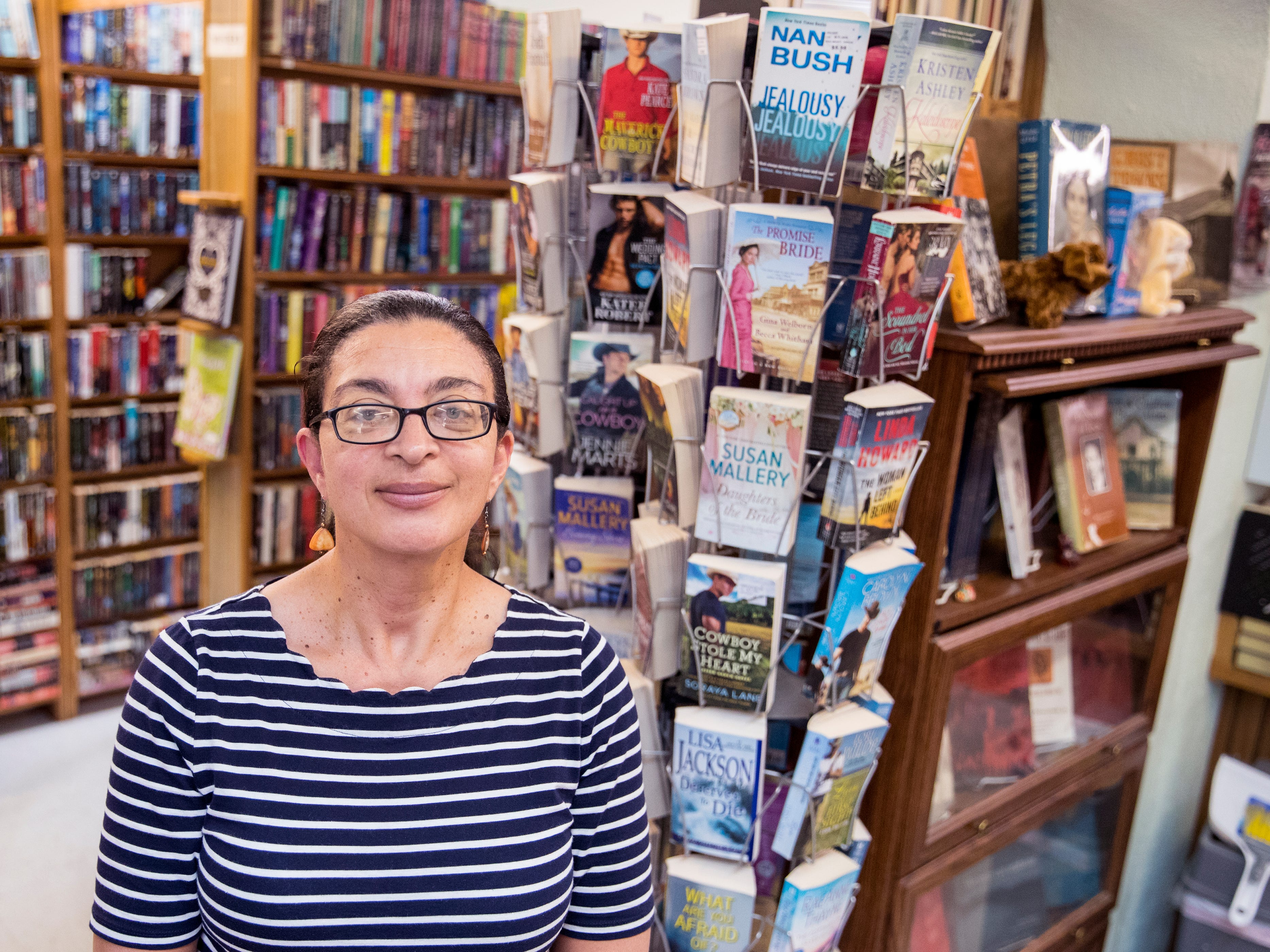 "Books Ink owner Jennifer Hay said her bookstore has become a community center. ""We don't have community spaces anymore."" she said. ""Nobody chats with their neighbors, nobody sits on a porch and waves to people and I just wanted a place where if somebody came in they would be able to talk to another person."""
