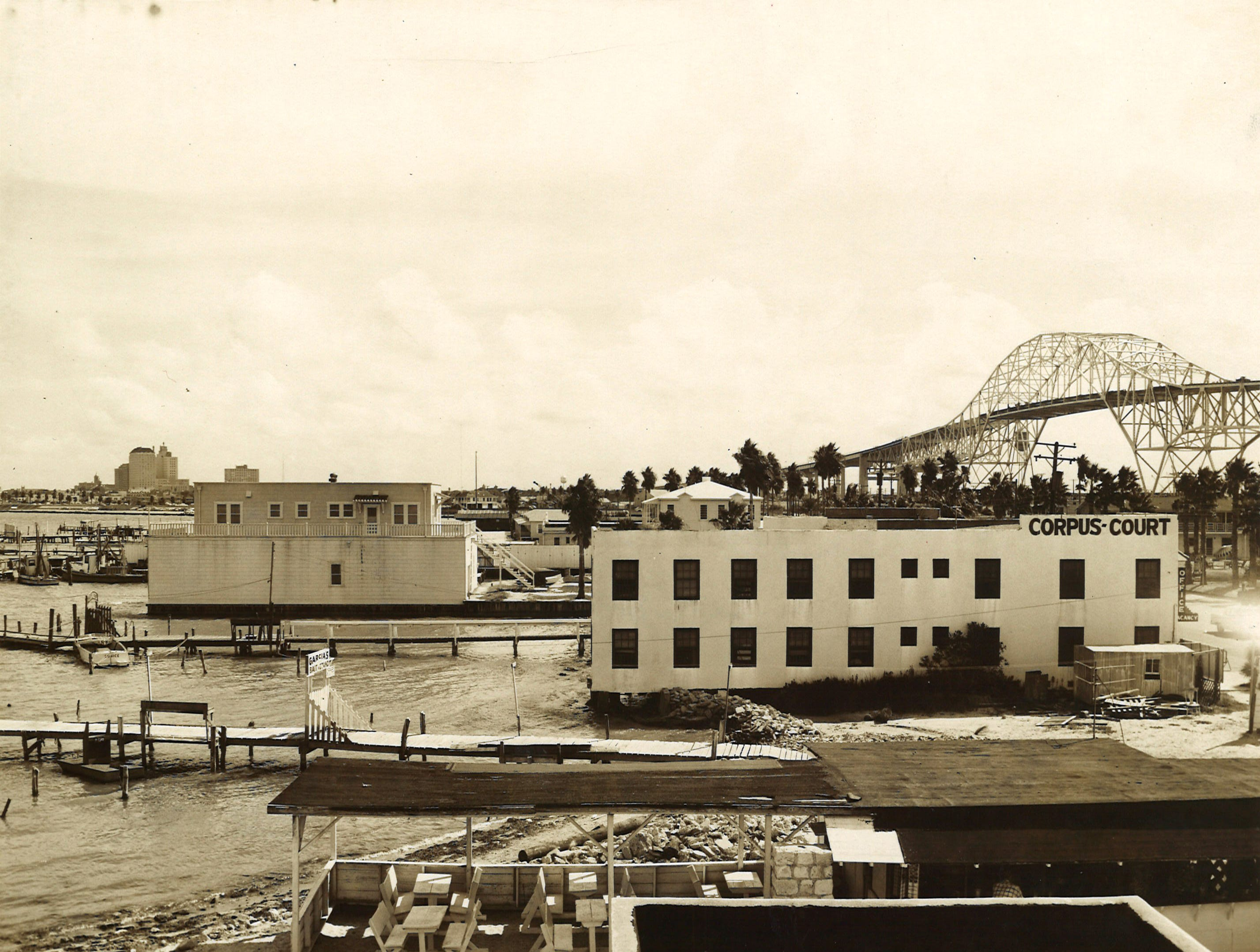 Looking toward the newly completed Harbor Bridge in Corpus Christi from North Beach in September 1959. The street in front of Corpus Court is North Shoreline.
