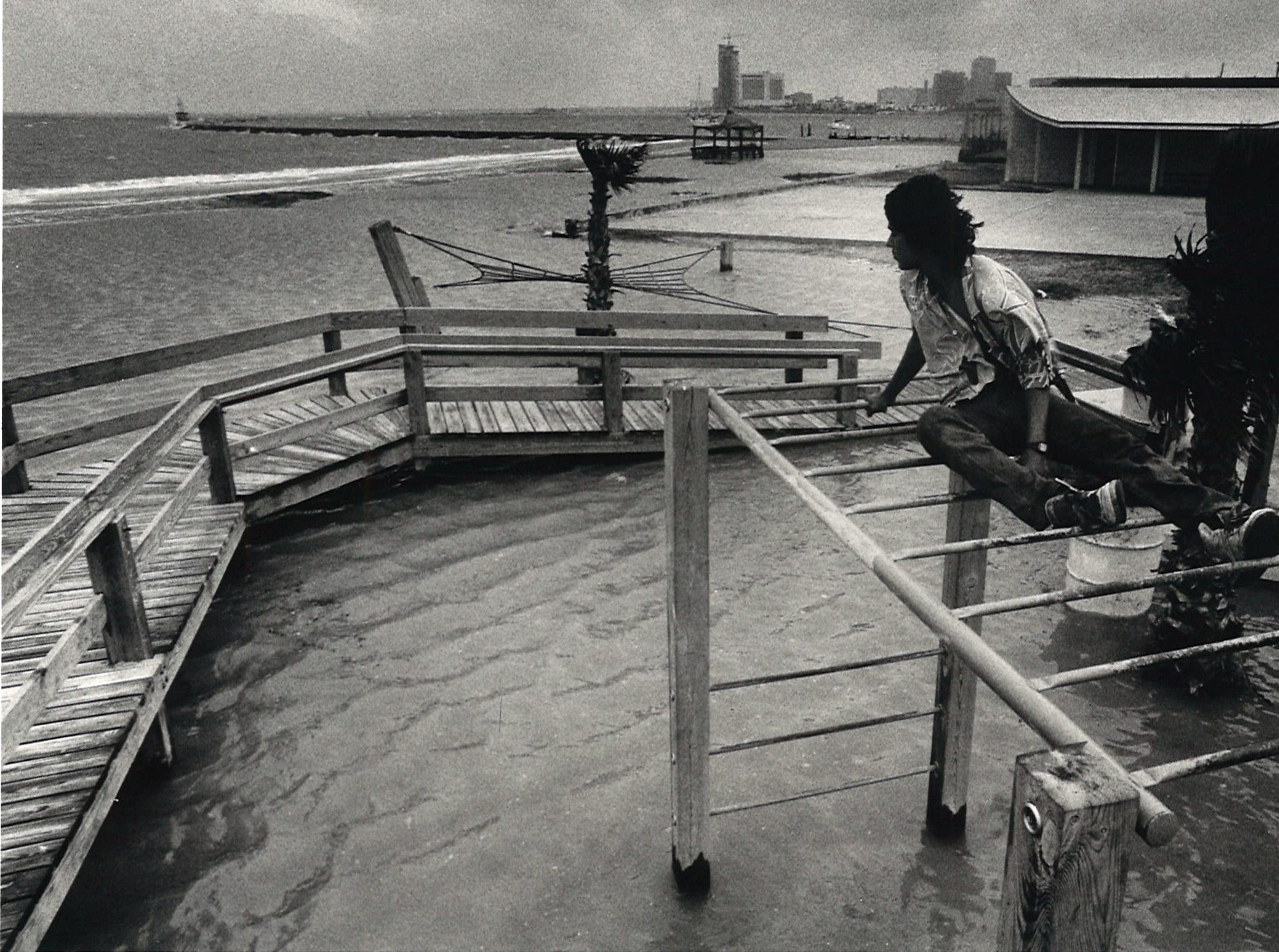 Richard Hernandez, 21, sits atop a flooded playground next to the Sandy Shores Hotel on Corpus Christi's North Beach on May 28, 1987. A combination of high tide, rain and winds flooded areas of North Beach.