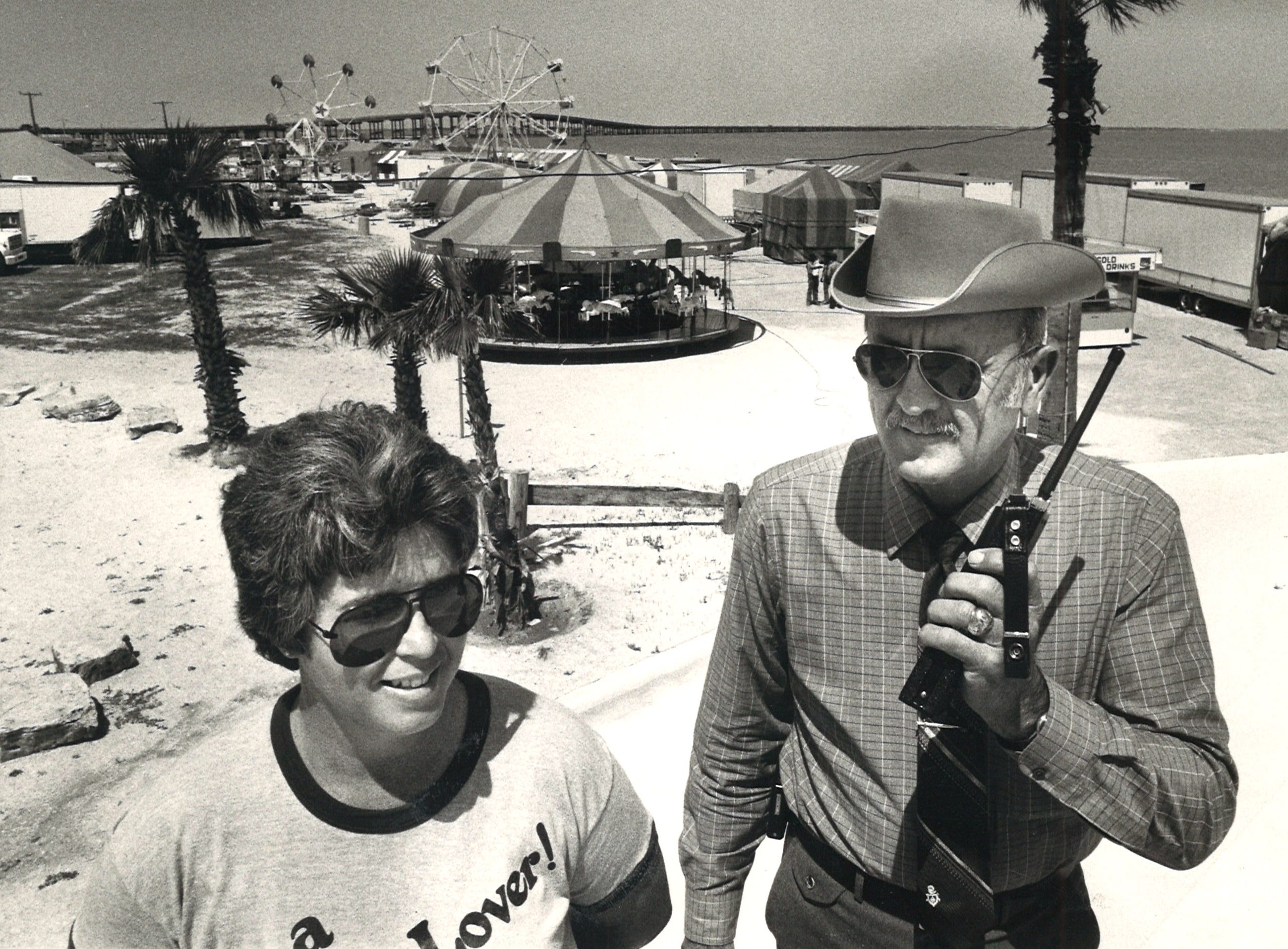 Sisu Morris, left, director of recreation centers, and Ken Krenek, director of parks, prepare for the activities with Beach Party on Corpus Christi's North Beach on April 8, 1983.