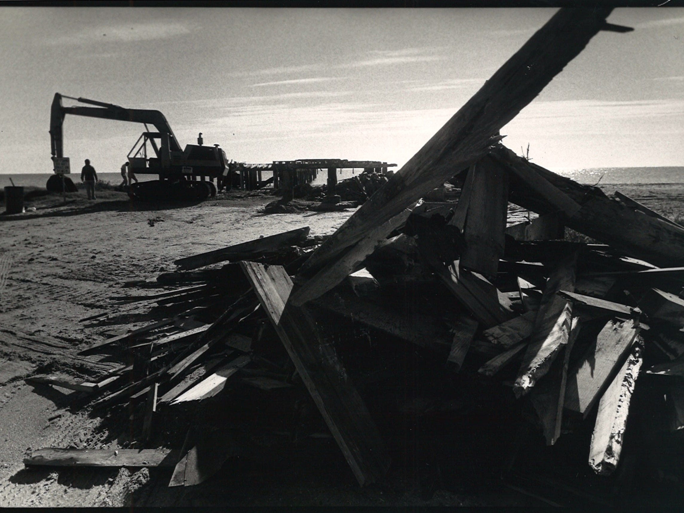 Kign Construction broke several chains and a backhoe while pulling out the pilings of a pier on Corpus Christi's North Beach on Jan. 17, 1985.