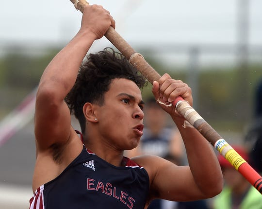 Veterans Memorial's Jacob Beltran runs to pole vault at the District 30-5A track meet field event finals on Wednesday, April 3, 2019, at Cabaniss Field. Beltran won third place in the event.