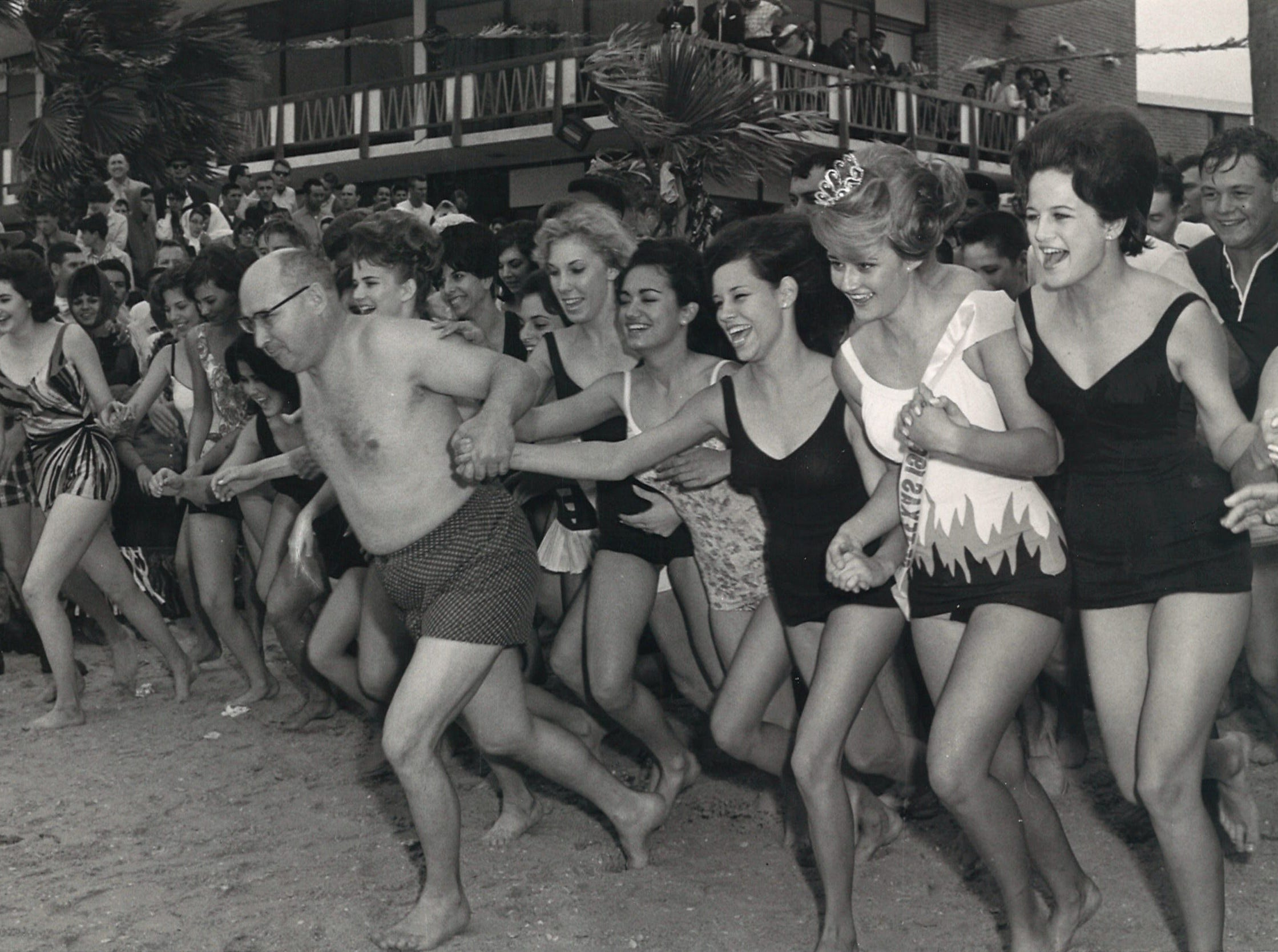 Civitan Club president Jack Blackmon led the charge into the water for the 1965 New Year's Day swim on North Beach.