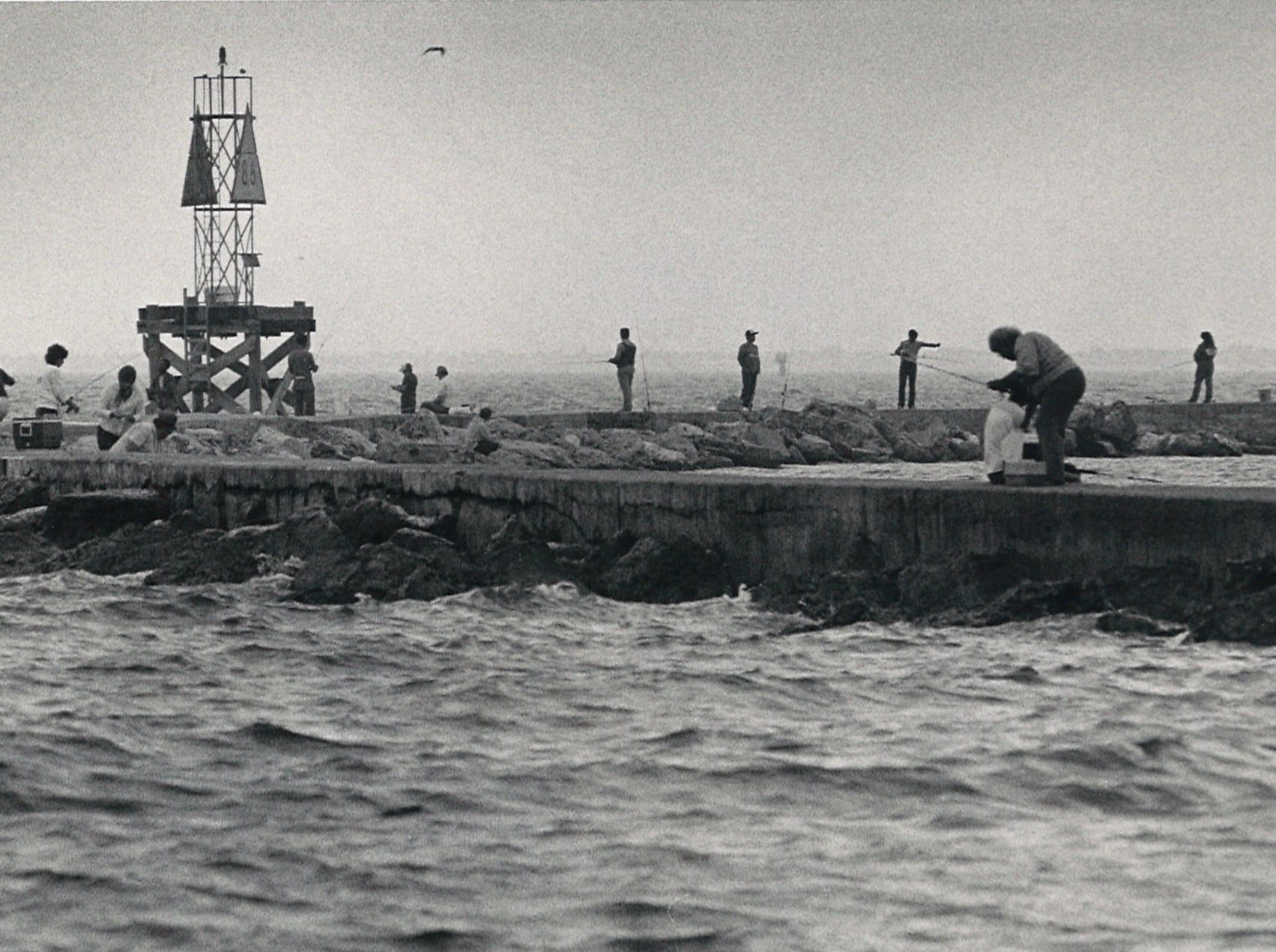 A busy day on the jetty on Corpus Christi's North Bach on Nov. 23, 1985.