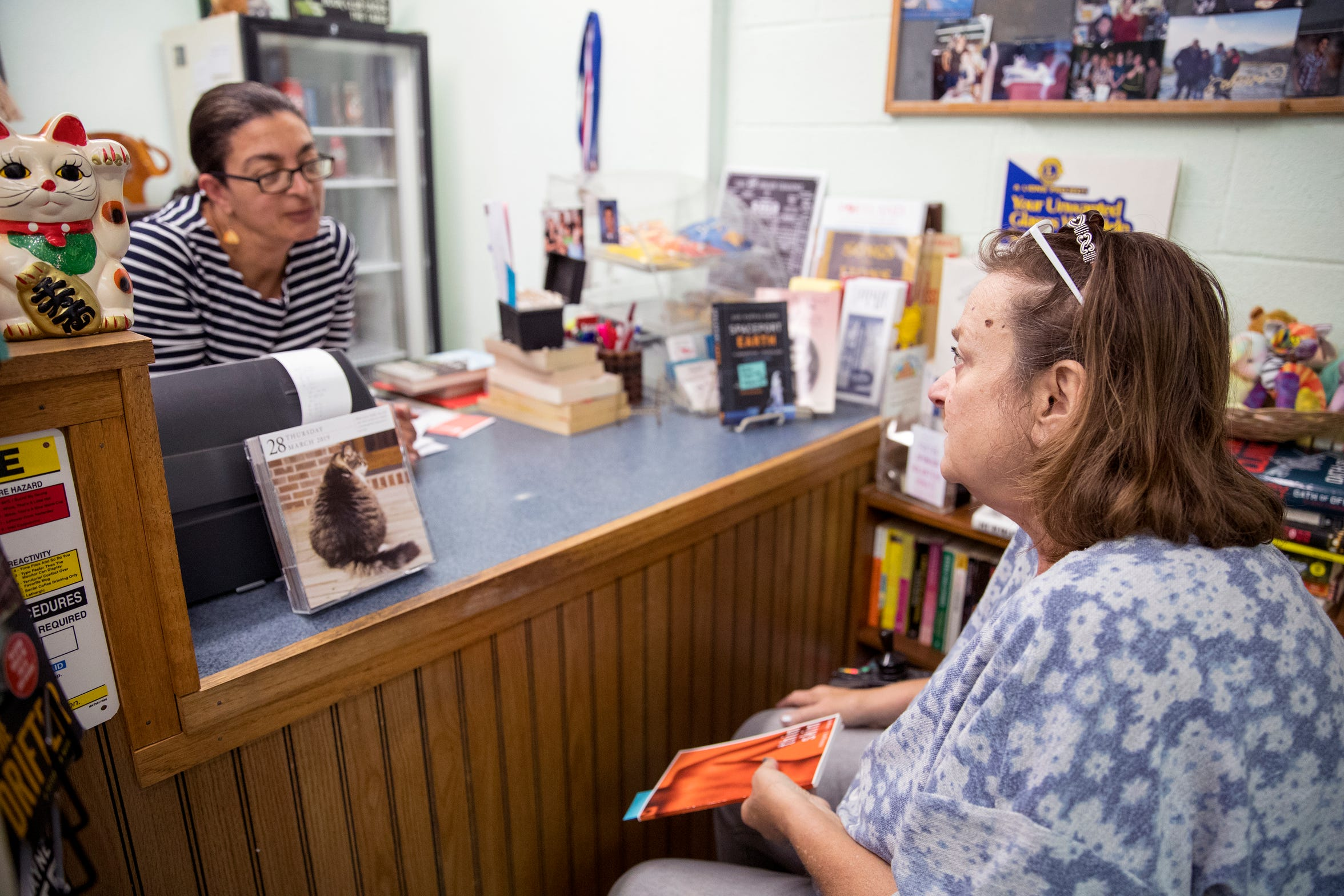 Books Ink owner Jennifer Hay (left) talks with customer Kelly Kimball last month. Kimball has been coming to the store since her children were three and 10 years old, they are now 18 and 25. She said the bookstore is a place of community in Portland.