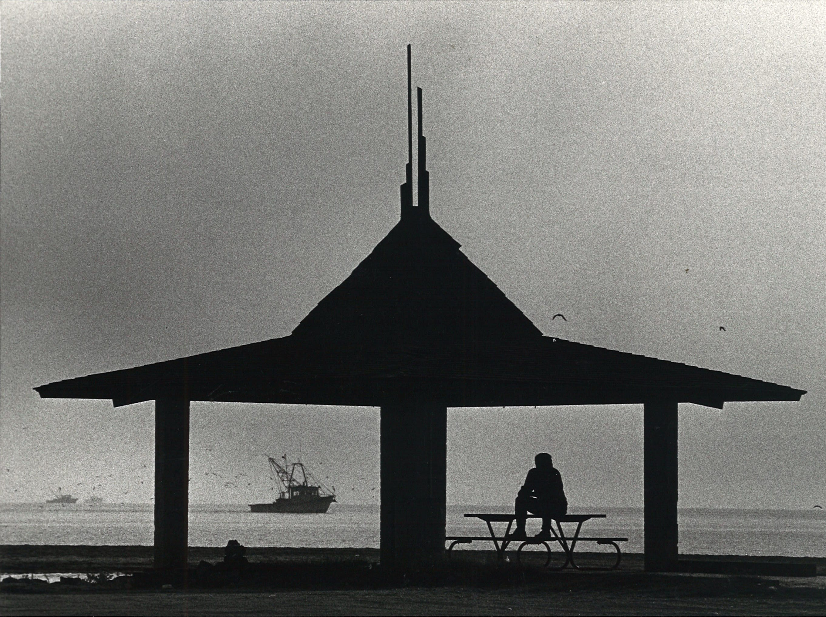 A tourist enjoyed the solitude early in the morning on Corpus Christi's North Beach in September 1981.