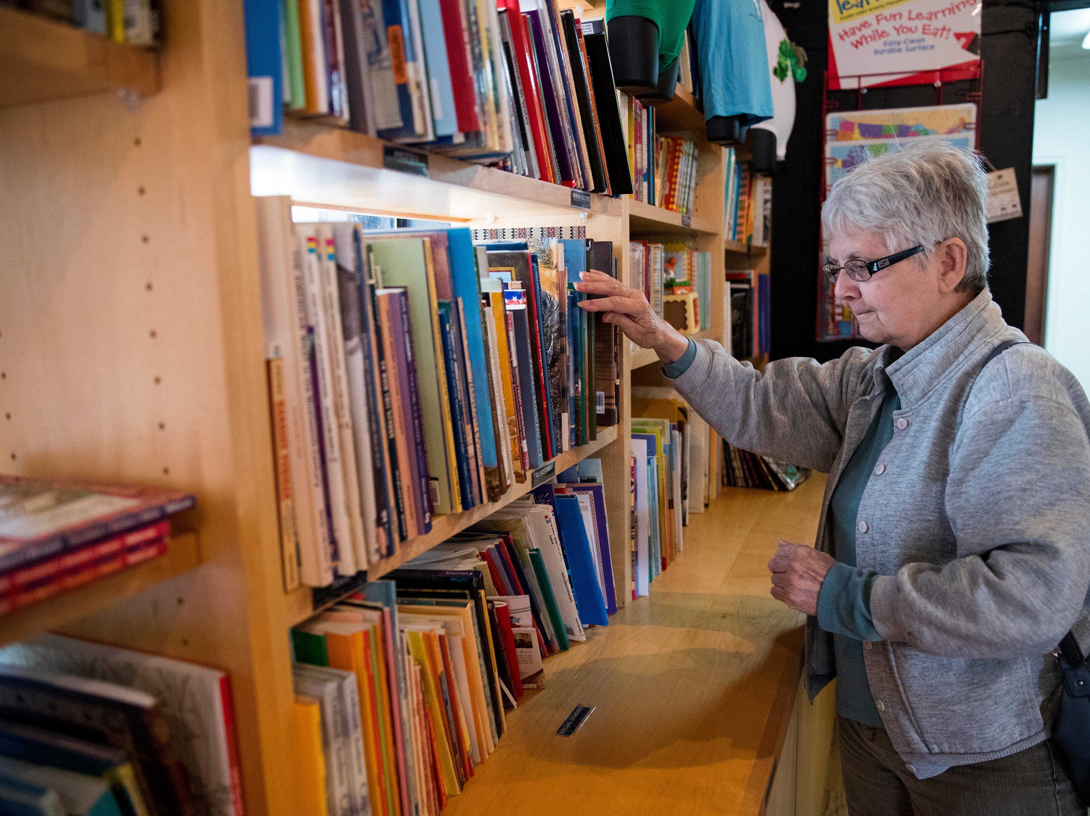 "Sharon Purcell shops at By the Book last month. She said she likes shopping at the bookstore because it is an independent bookstore and she has several grandchildren she shops for. ""The appeal of a locally owned bookstore is personalized, customized attention,"" she said."