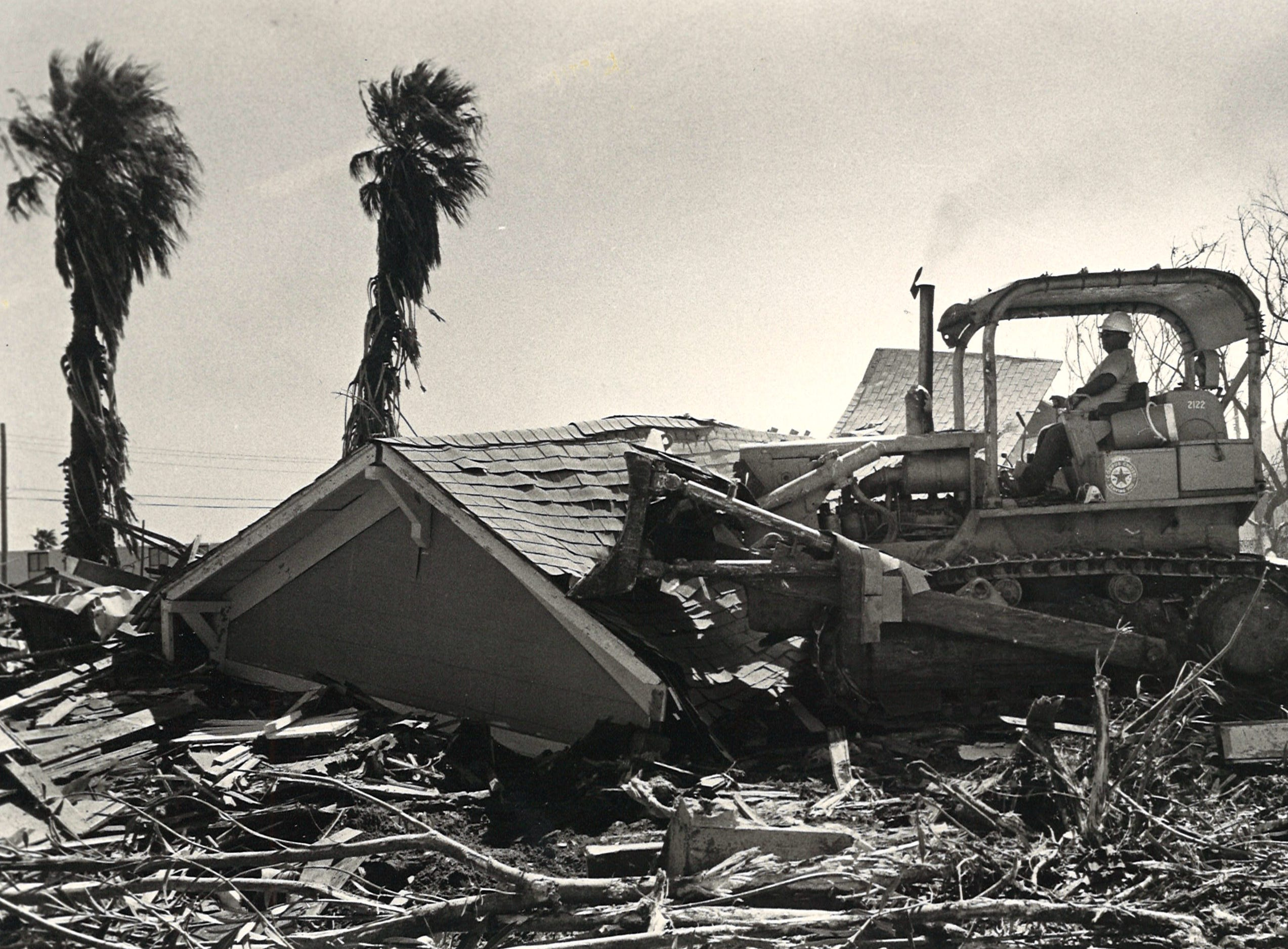 A city worker bulldozes the Sea Shell Inn on Corpus Christi's North Beach on Aug. 21, 1980. Many buildings were razed after suffering heavy damage from Hurricane Allen earlier that month.