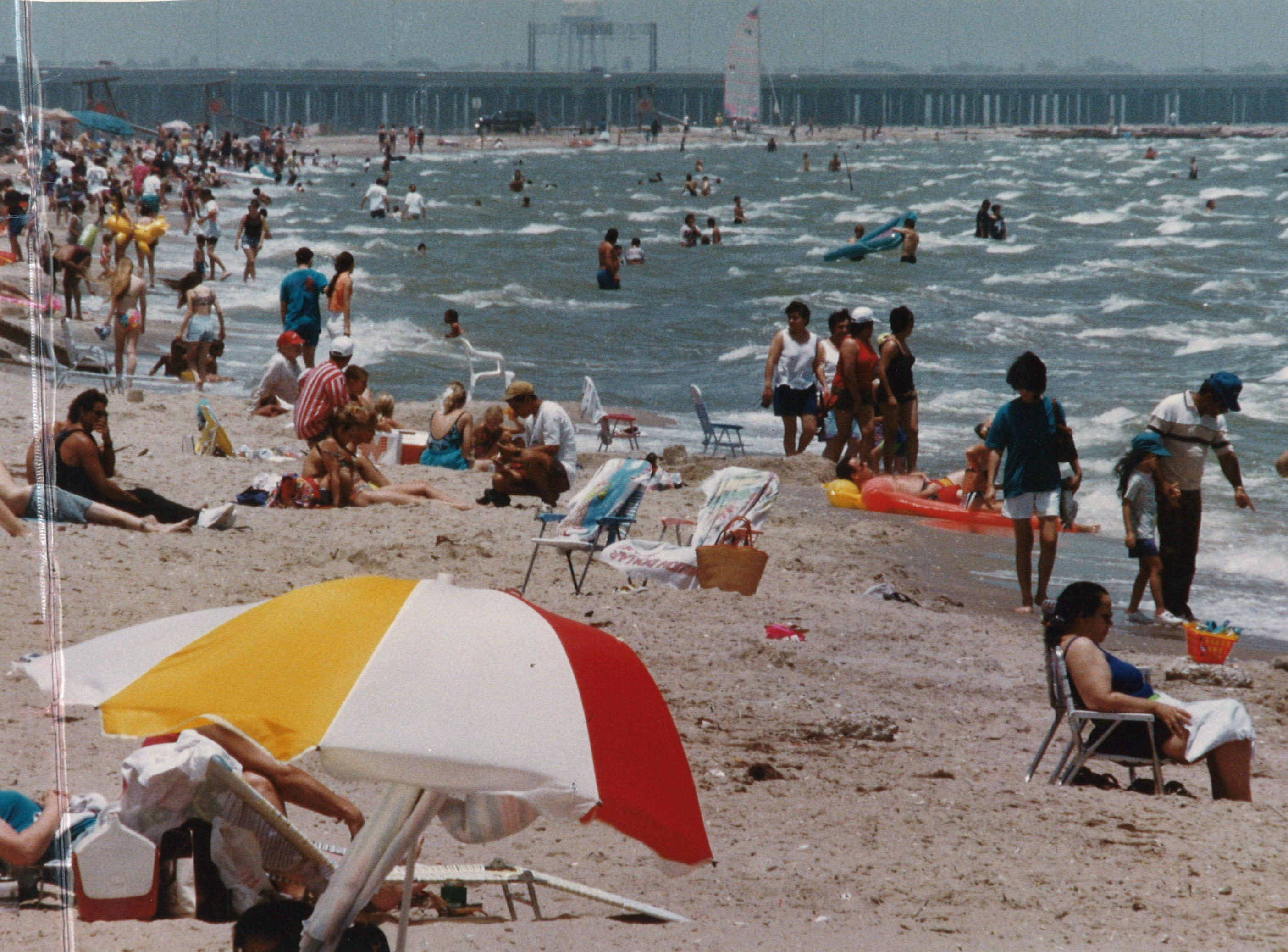 Warm weather dre large scrowds of people to Corpus Christi's North Beach on July 16, 1994. This is the view looking north toward the Nueces Bay Causeway.