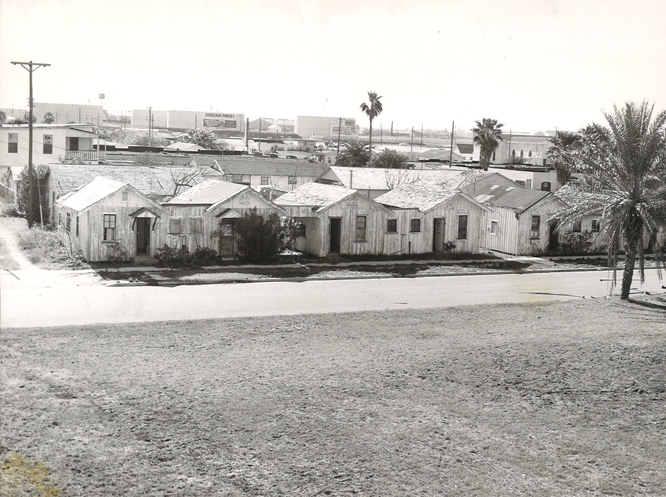 Tourist courts on Corpus Christi's North Beach in January 1959. Storage tanks for the Port of Corpus Christi are seen in the background.
