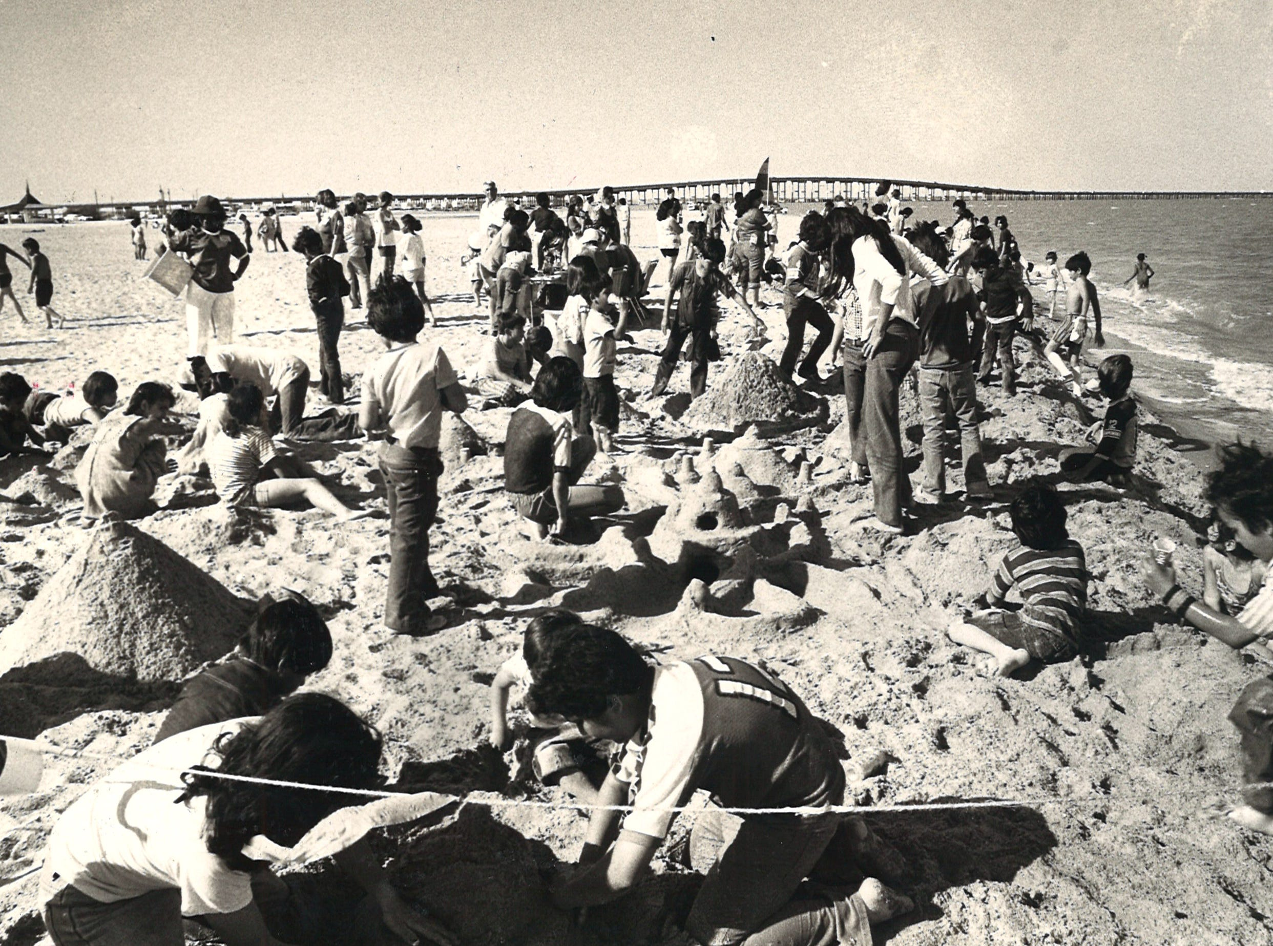 People dig in the sand during a sand castle building competition on North Beach, named Corpus Christi Beach at the time, in March 1978. The competition was part of the festivities to celebrate the completion of a beach restoration project.