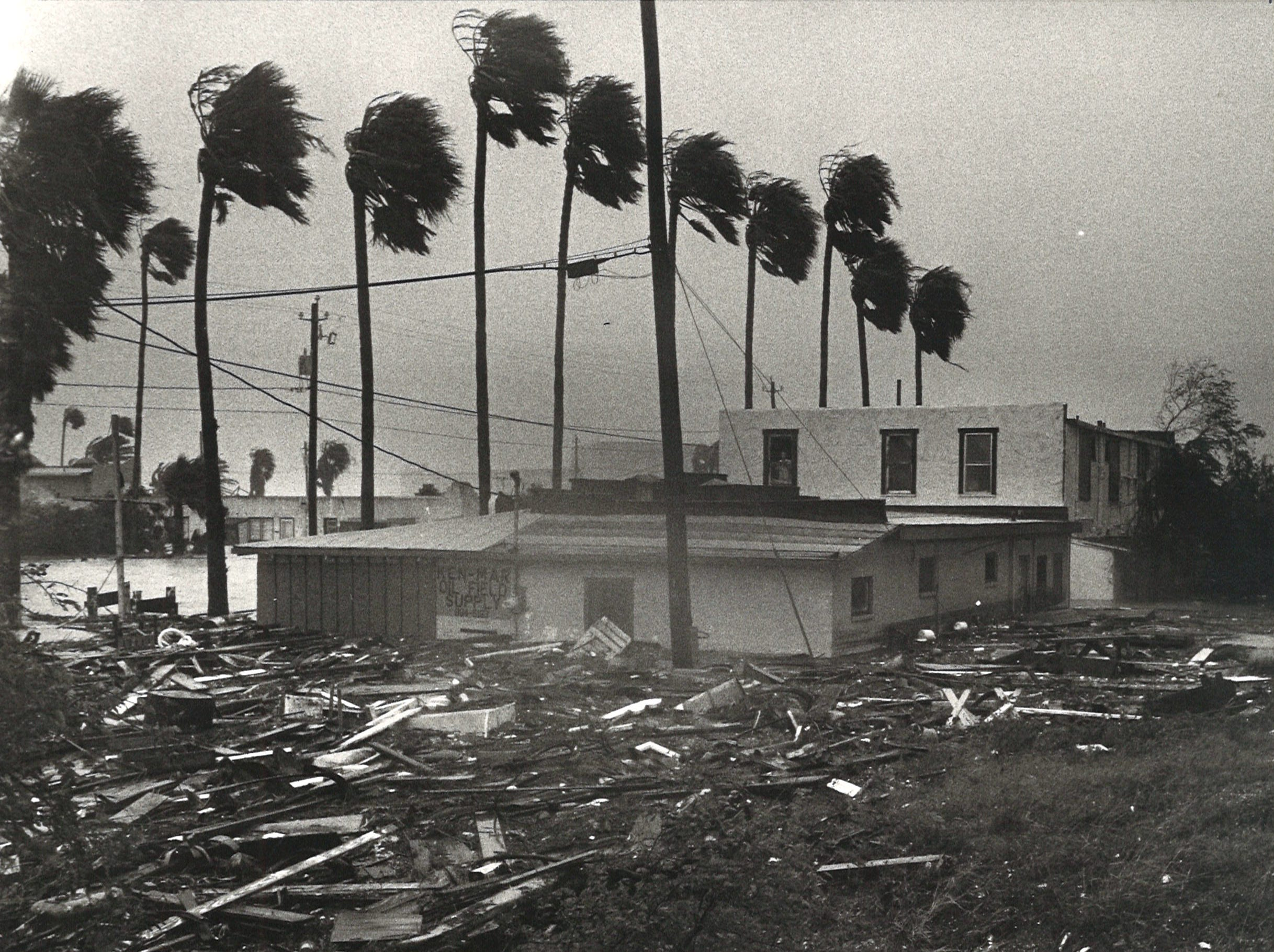 Water pushes debris past Surfside Blvd. on Corpus Christi's North Beach as Hurricane Allen hit near Brownsville in 1980. When this photo was taken about noon on Aug. 10, the water for 4-5 feet deep.