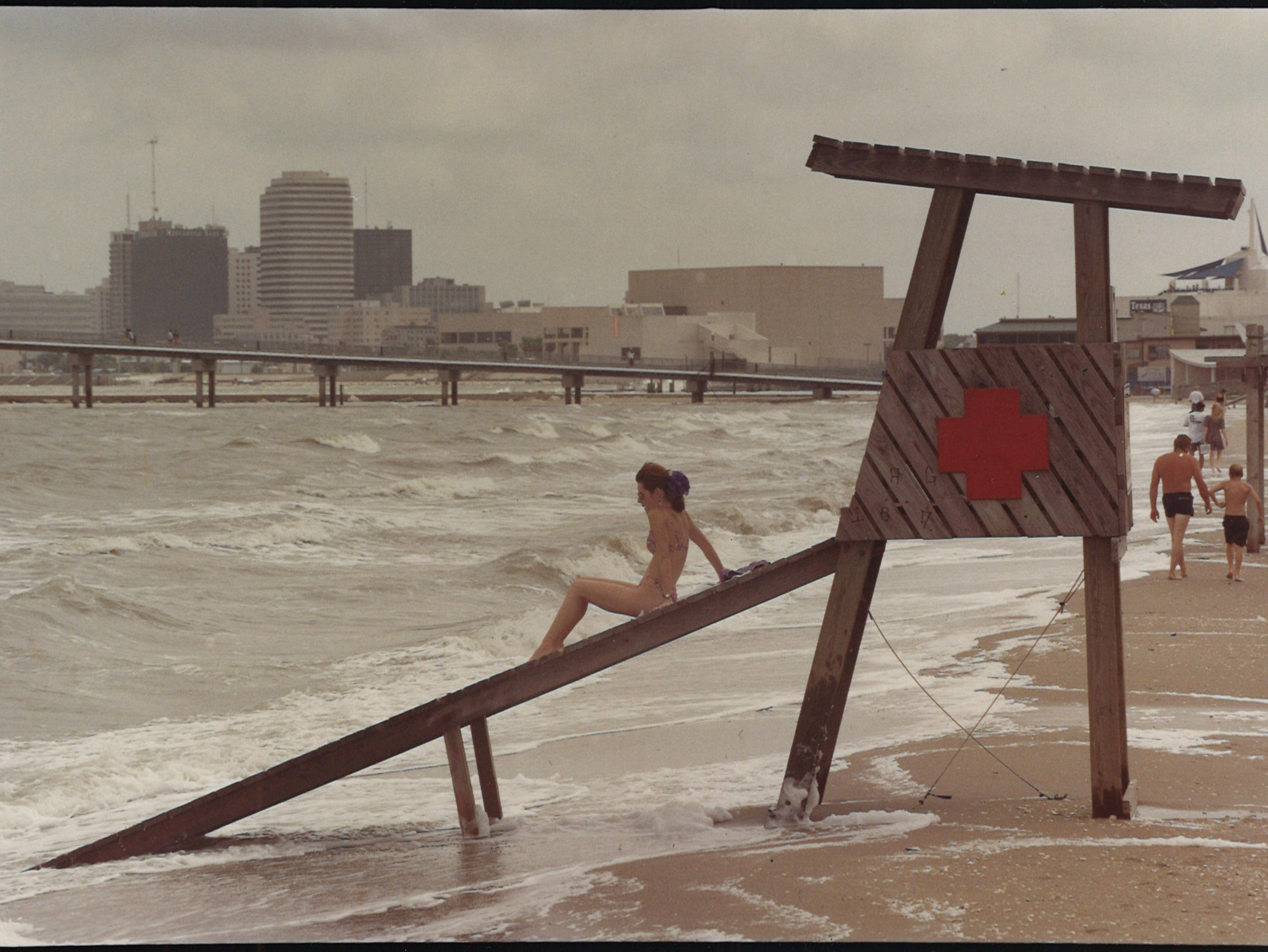 Lanita Edwards of San Antonio sits on a lifeguard stand as the tide comes up on Corpus Christi's North Beach on April 29, 1994.