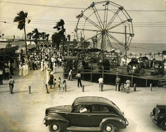 A boardwalk, Ferris wheel, salt-water pool, water slide, amusement park, diving platform and fishing piers attracted thousands of visitors to North Beach in the 1940s.