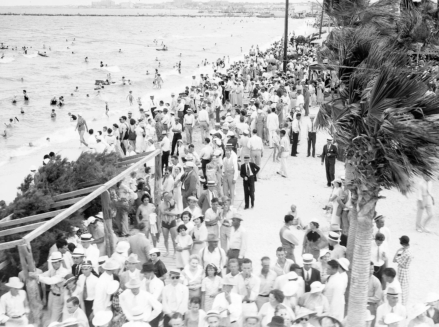 Corpus Christi's North Beach in 1935, when large crowds of bathers and strollers were attracted to the area in the summertime. The area shown was a choice bathing spot.
