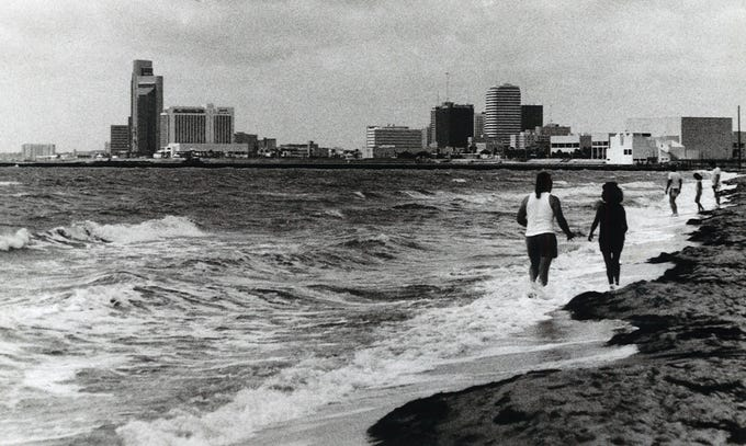 People enjoyed Corpus Christi's North Beach the day before the USS Lexington arrived at her new berth next to the Texas State Aquarium on June 17, 1992.