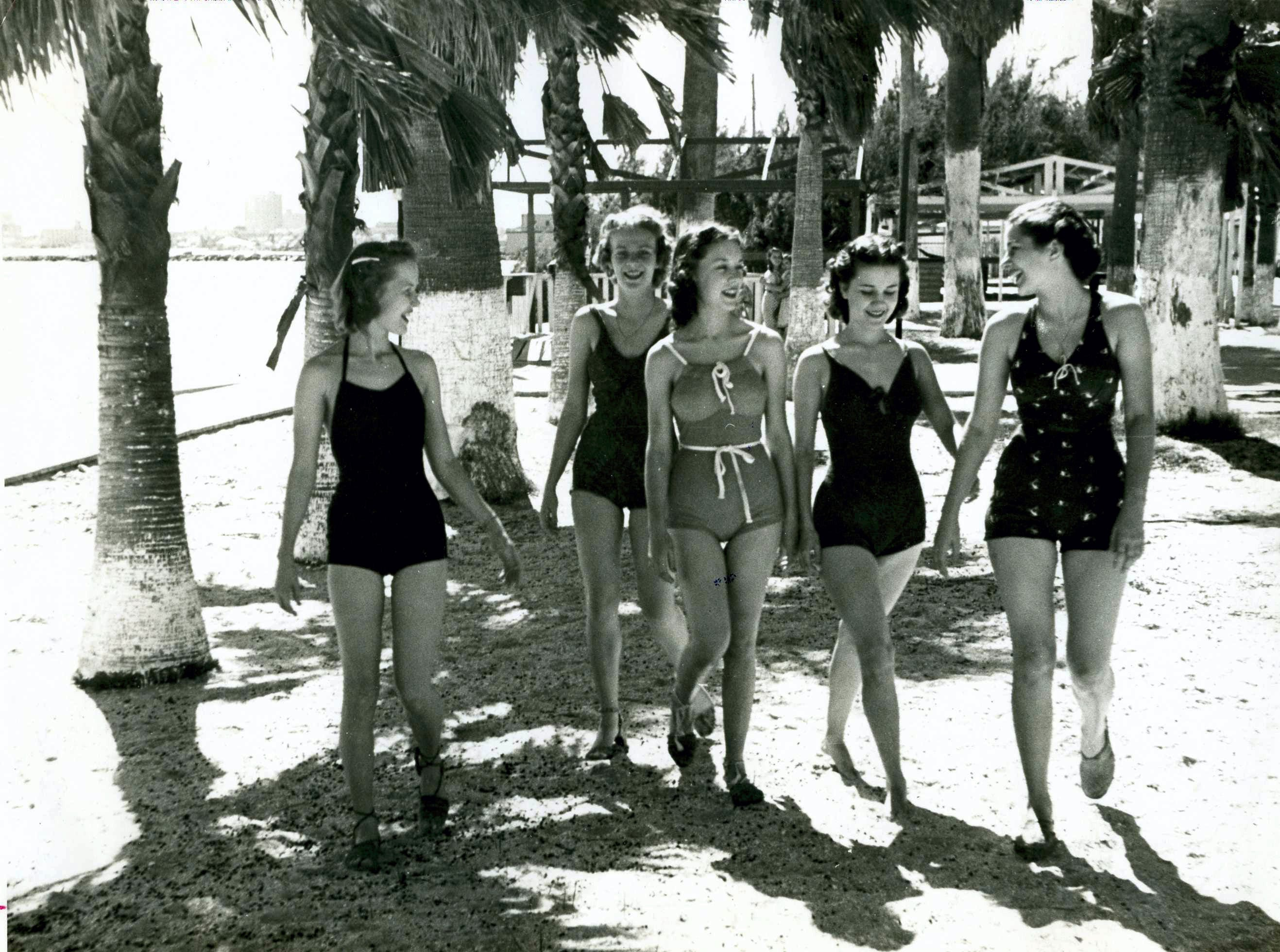 Young women stroll along Corpus Christi's North Beach in the 1940s.