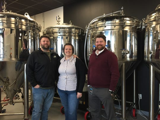 Josh and Krystle Lockman of Mullica Hill and Greg Fletcher of Pedricktown are partners in Axe & Arrow Microbrewery, set to open its doors Saturday in downtown Glassboro.