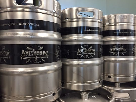 Kegs line a wall of the brewing area of Axe & Arrow Microbrewery in Glassboro.