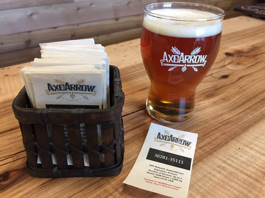 Axe & Arrow Microbrewery owners say they are aiming to be as sustainable as possible. Their business cards, for instance, are made from wildflower seed paper and can be planted in your yard.