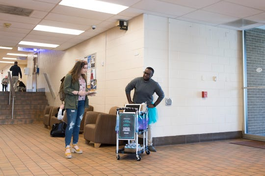 Madison Mulcahy, left, and Michael Beckford II waits to speak with students about consent in the halls of Rowan College at Gloucester County in Sewell, N.J. Monday, April 1, 2019.