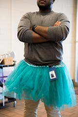 Michael Beckford II sports a tutu as he waits to speak with students about consent in the halls of Rowan College at Gloucester County in Sewell, N.J. Monday, April 1, 2019.