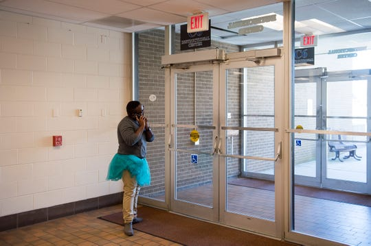 Michael Beckford II sports a tutu as he takes a phone call in between talking to students about consent at Rowan College at Gloucester County in Sewell, N.J. Monday, April 1, 2019.