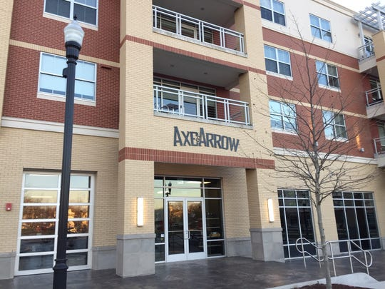 Axe & Arrow Microbrewery is on the ground floor of this large housing complex on West High Street in Glassboro. It faces Glassboro Town Square, a large outdoor area used by the borough for community events.