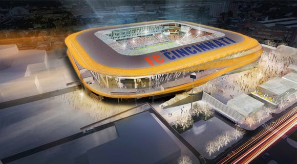 Evening aerial view of the current rendering. Previous rendering showed the entire stadium wrapped in material that would glow. That's been amended to the ribbons of color shown here.