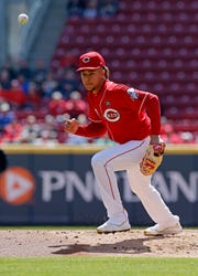 Cincinnati Reds starting pitcher Luis Castillo (58) knocks down and plays a comebacker off the bat of Milwaukee Brewers second baseman Travis Shaw (21) in the second inning of the MLB National League game between the Cincinnati Reds and the Milwaukee Brewers at Great American Ball Park in downtown Cincinnati on Wednesday, April 3, 2019. The Brewers led 1-0 after three innings.