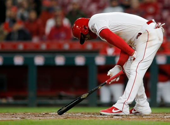 Cincinnati Reds right fielder Yasiel Puig (66) takes a moment after fouling a ball off his foot in the eighth inning of the MLB National League game between the Cincinnati Reds and the Milwaukee Brewers at Great American Ball Park in downtown Cincinnati on Tuesday, April 2, 2019.