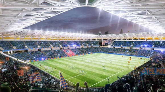 General view of the inside. The overhead canopy is filled in, shielding fans from weather,