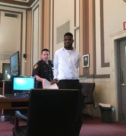 A sheriff's deputy leads Timothy Kirk into Hamilton County Common Pleas Judge Jody Luebbers' courtroom Wednesday, April 3, 2019, for the start of his trial.