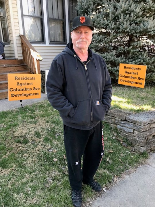 Wallace Power of Hyde Park fears his street, Columbus Avenue, could soon become a parking lot for bars on nearby Wasson Road.